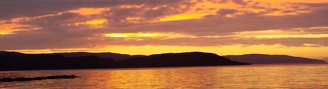 Scottish themed weddings Portree sunset Isle of- Skye image